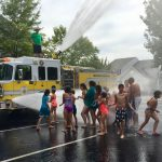 East Stratford HOA Hose down getting soaked on a hot summer day
